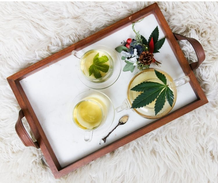 3 glasses of tea with cannabis leaves, CBD oil, and CBD salts