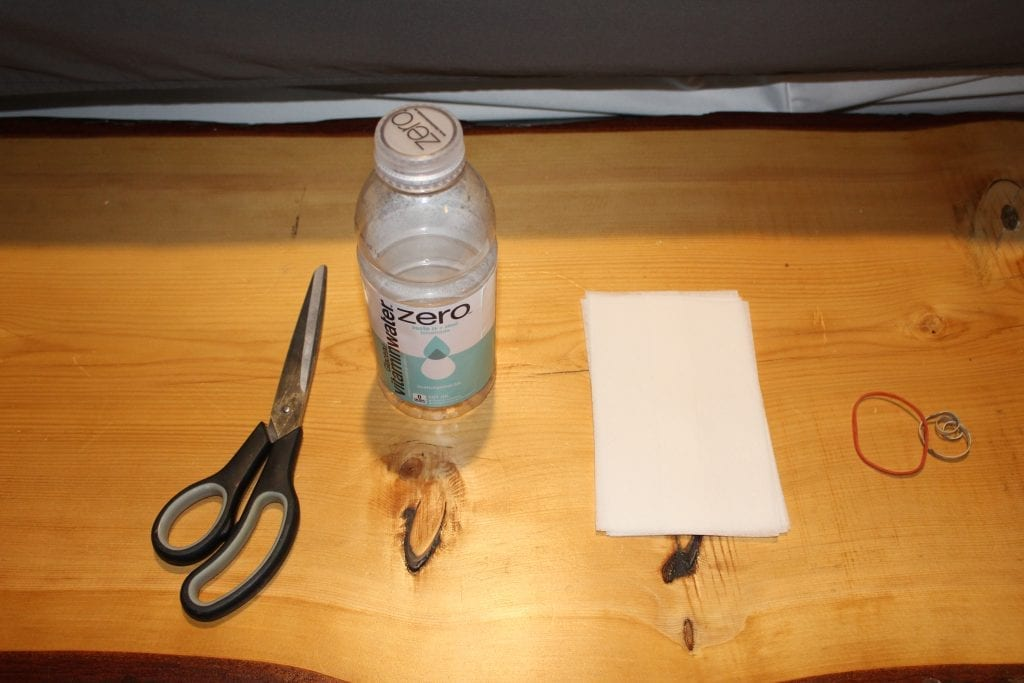 Scissors, plastic bottle, dryer sheets, and elastics. Everything you need to make a sploof