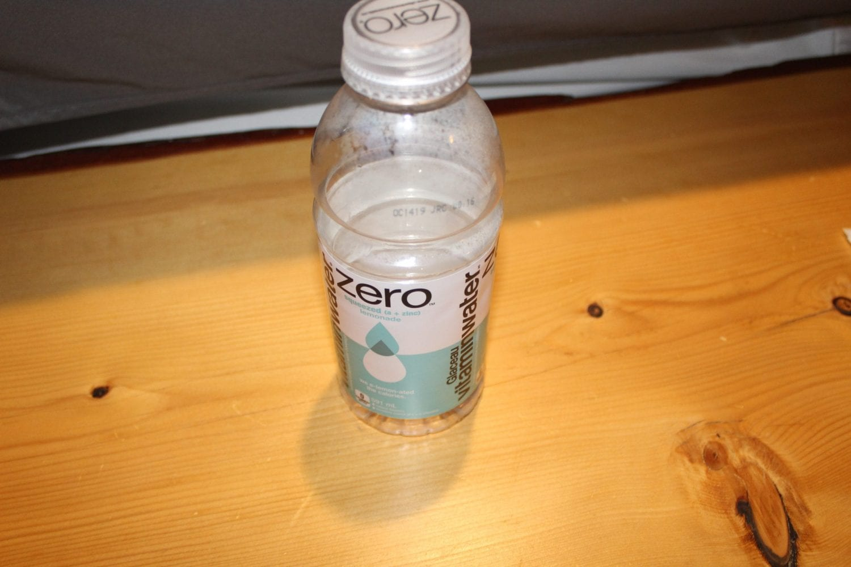 Empty Vitamin water bottle on wooden table