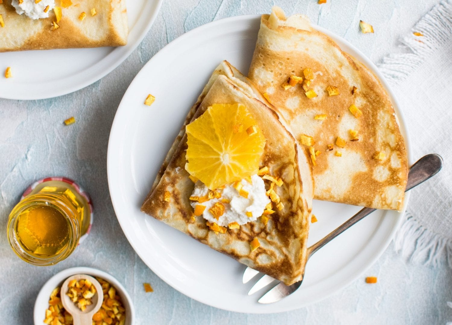 weed crepes that are golden brown with oranges on them.