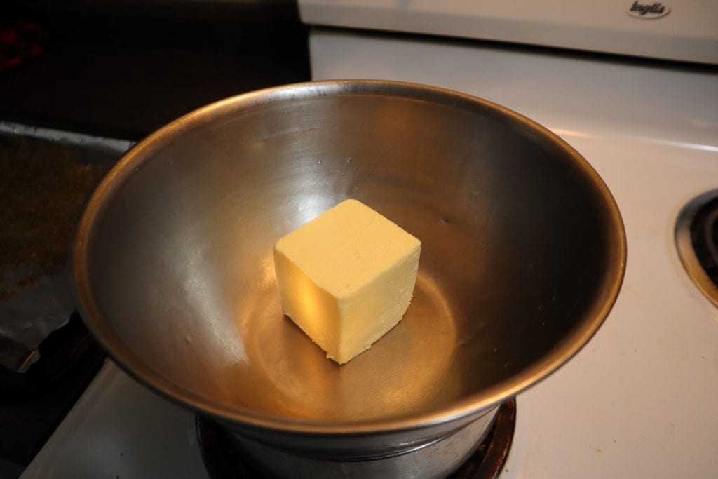 butter inside the double boiler.