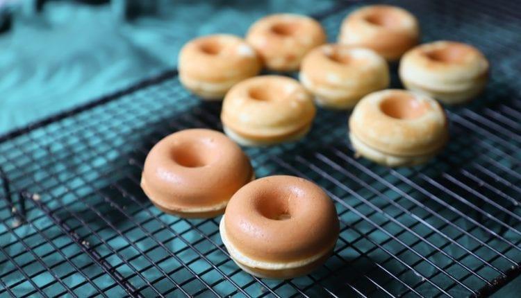 glazed donuts on a baking tray