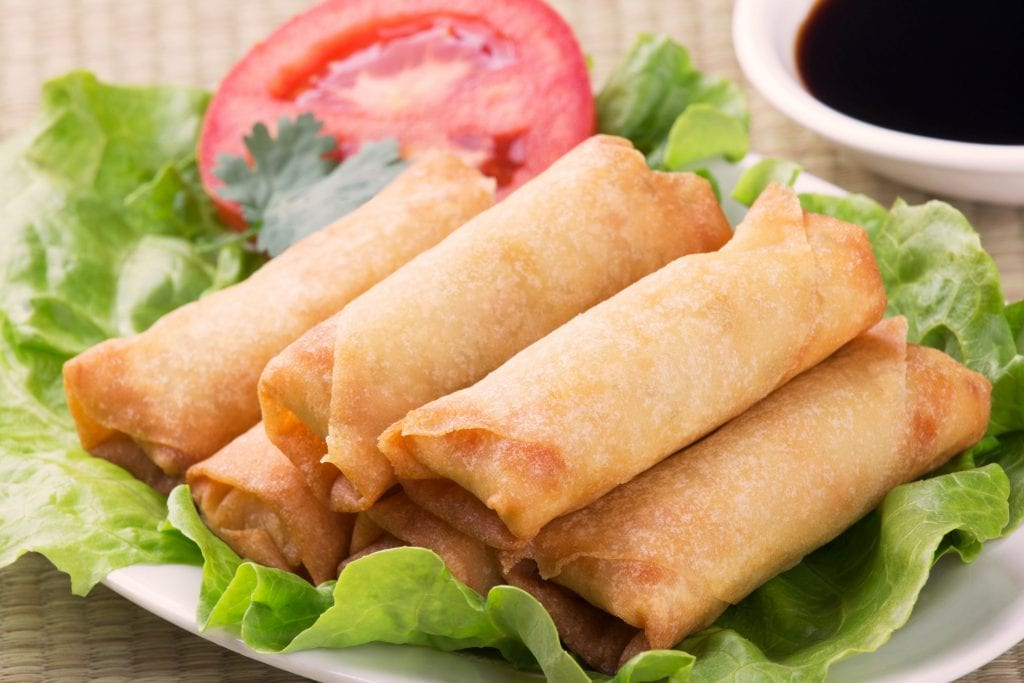 """Six weed spring rolls on a piece of lettuce and tomato on a white plate """"class ="""" wp-image-9720"""