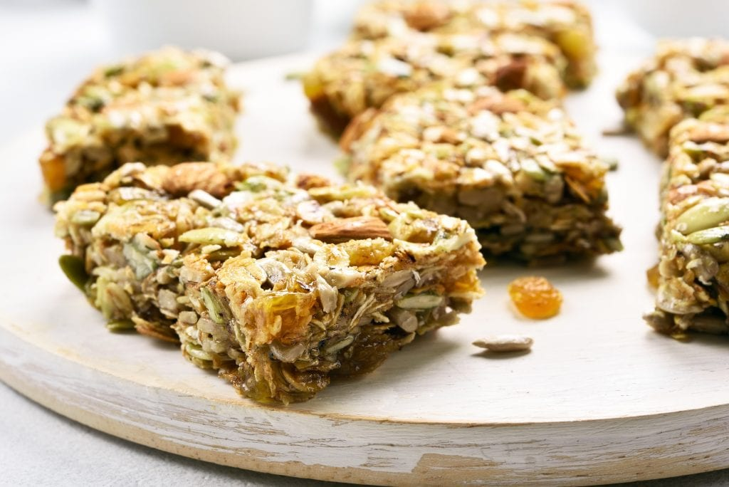 Close up of a weed granola bar on wooden board. Healthy meal for breakfast.