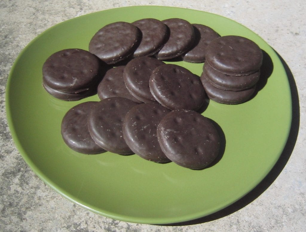 weed thin mint cookies on a green plate. Chocolate covered weed thin mint cookies.