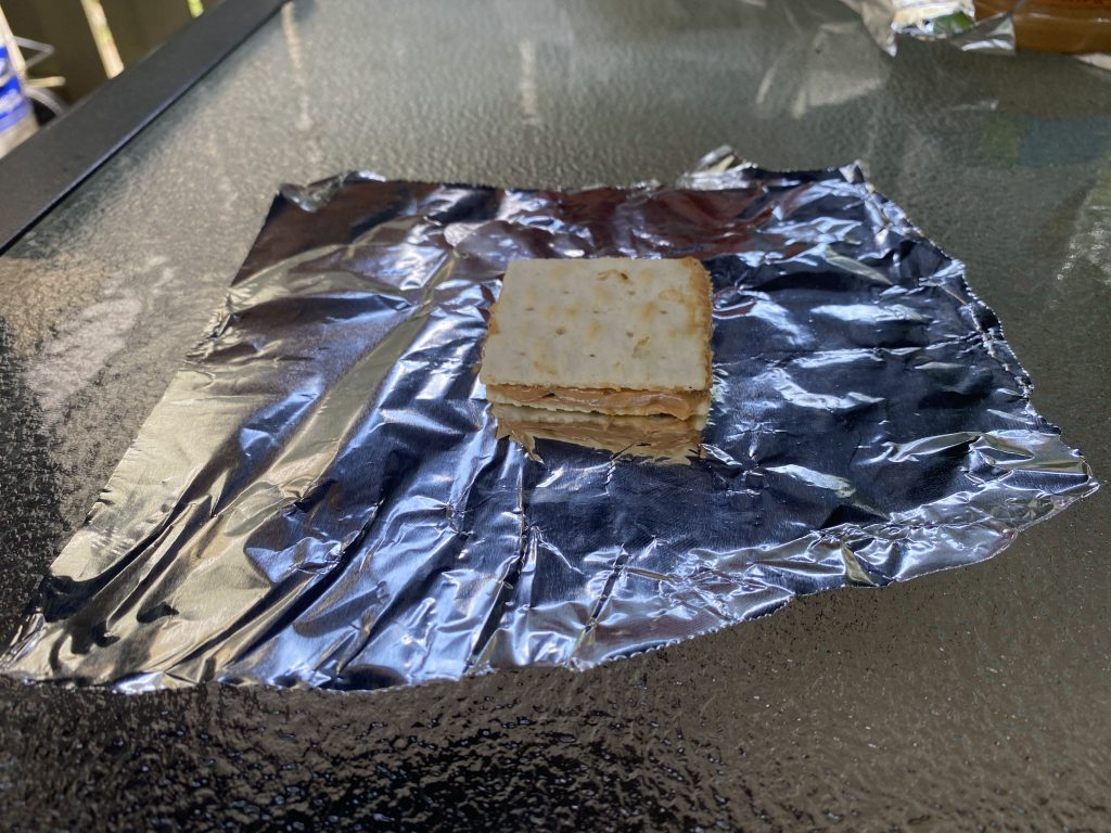 a weed firecracker on aluminum foil before being put in the oven.