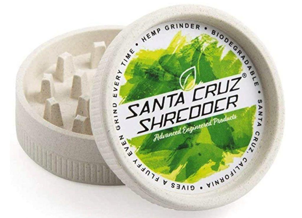 Santa Cruz Shredder two piece hemp grinder on a white table